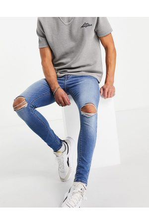 ASOS Spray on jeans with power stretch in mid wash with knee rips-Blue