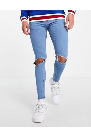 ASOS Spray on jeans with power stretch in light stone wash with open knee rips-Blue