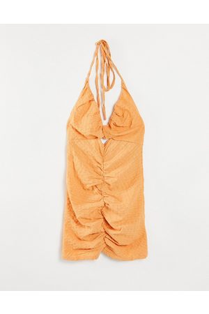Missguided Halterneck ruched mini dress with cut outs in peach-Orange