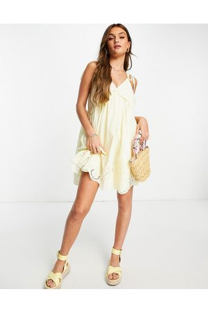 ASOS Dobby mini smock sundress with tie shoulders and broderie hem in yellow