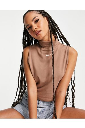 Nike Essential sleeveless top with mock neck in earth brown