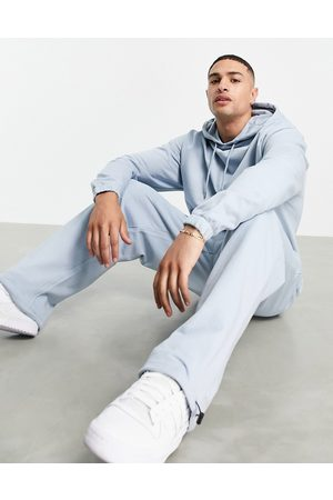 ASOS Tracksuit with oversized hoodie and super oversized joggers with toggles in pastel blue