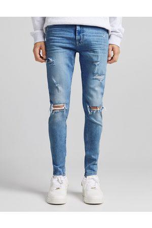 Bershka Super skinny jeans with rips in dark blue