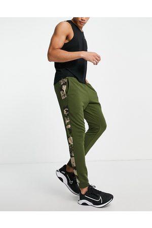 Nike Camo tapered joggers in khaki-Green