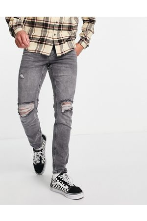 ASOS Stretch slim jeans in washed grey with knee rips-Black