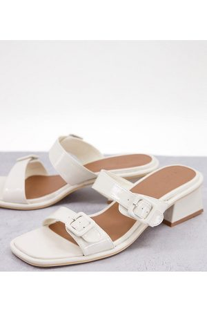 ASOS Wide Fit Willow buckle detail heeled mules in white patent