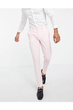 ASOS DESIGN Skinny suit trousers in pastel pink