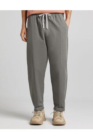 Bershka Loose fit drop crotch trousers in grey