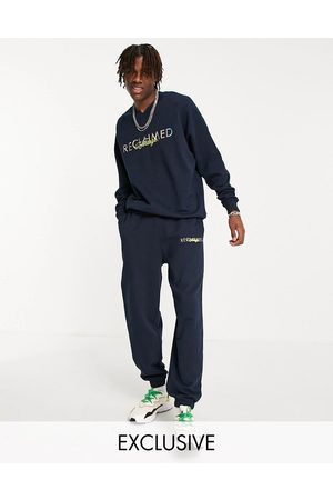 Reclaimed Vintage Inspired 90s joggers with logo embroidery-Navy