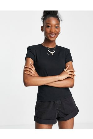 Nike Padded sleeve t-shirt in black