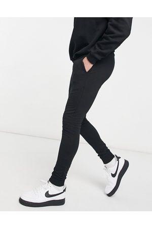 ASOS Super skinny joggers in black