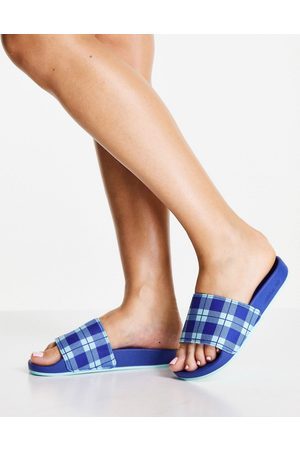 adidas Adilette terry towelling sliders in blue with check print