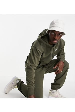 The North Face Herre Chinos - Oversized Essential joggers in khaki Exclusive at ASOS-Green