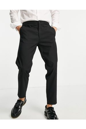 SELECTED Smart trousers in slim tapered fit with elasticated waist in black