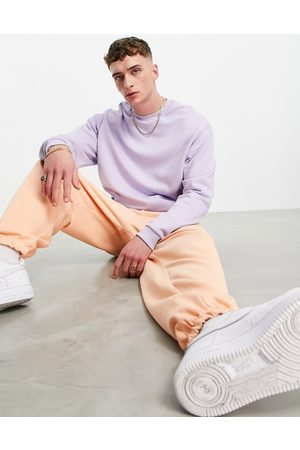 ASOS Herre Joggebukser - Tracksuit with oversized hoodie and super oversized joggers in purple/orange-Multi