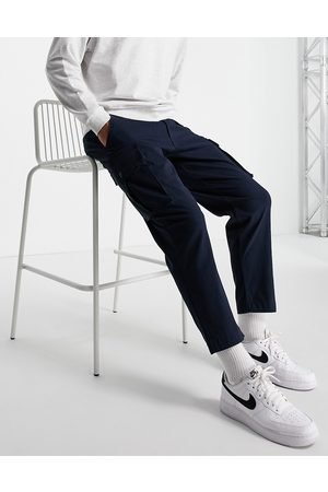 SELECTED Loose fit tapered cargo trousers in navy with organic cotton