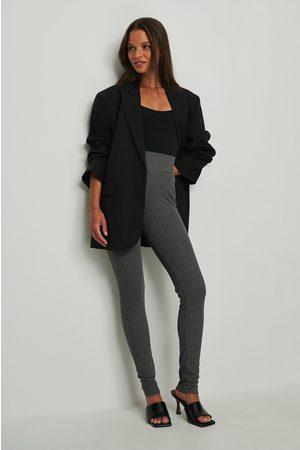 NA-KD Dame Leggings - Resirkulerte lange leggings med ribber