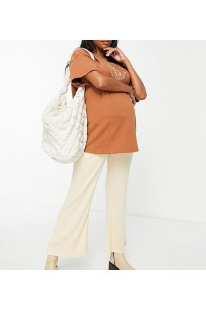 ASOS Dame Sett - ASOS DESIGN Maternity co-ord under the bump slouchy textured rib trouser in yellow-Neutral