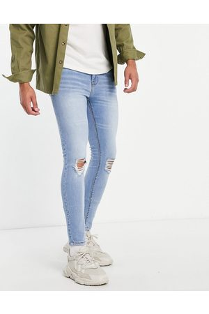 ASOS DESIGN Spray on jeans with power stretch in 'less thirsty' light wash with knee rip-Blue