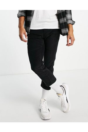 Another Influence Trousers with front pocket detail in black