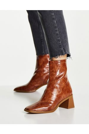 ASOS DESIGN Raider mid-heel ankle boots in tan-Brown