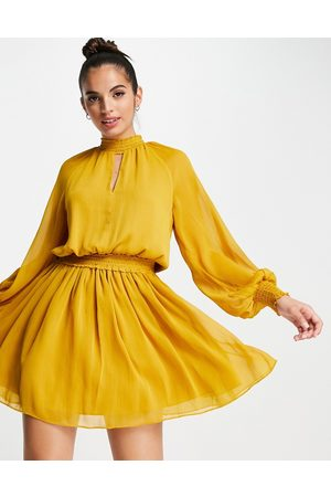 Forever New 70s keyhole long sleeve mini dress in mustard-Yellow