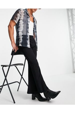 ASOS Herre Joggebukser - Skinny flared jersey joggers with front split in black