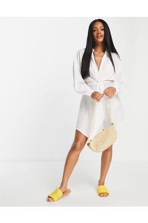 ASOS DESIGN Dame Strandkjoler - Jacquard twist beach mini dress in white