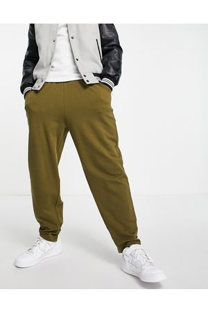 ASOS Herre Joggebukser - Organic oversized joggers with ankle strap in green