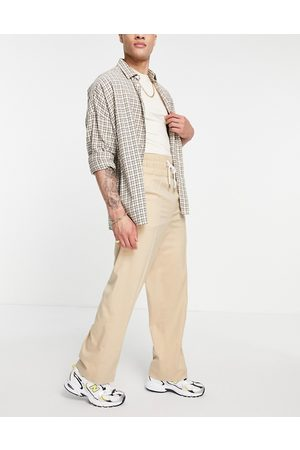 ASOS DESIGN Herre Chinos - Wide leg smart trousers with elasticated waist band in stone cross hatch-Neutral