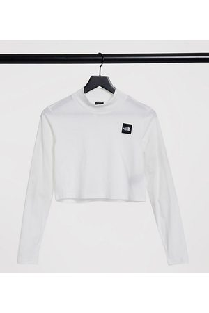 The North Face Dame Langermede - Nekku long sleeve t-shirt in white Exclusive at ASOS
