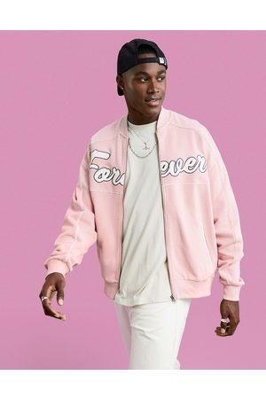 ASOS DESIGN Herre Bomberjakker - Oversized jersey bomber jacket in pink with large text applique