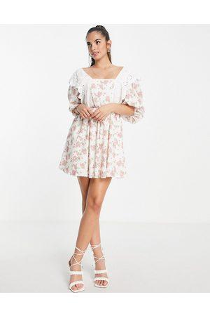 In The Style X Lorna Luxe exclusive trim bib detail mini smock dress in rosebud floral print-Multi