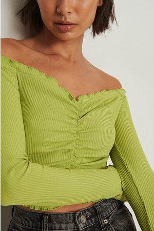 NA-KD Dame Singleter - Ribbetopp uten skuldre og med rysjer