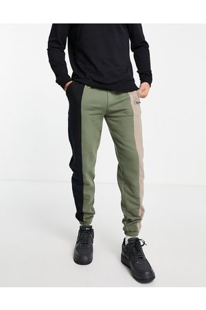 Good For Nothing Herre Joggebukser - Spliced joggers in black and khaki with mixed logo print-Multi