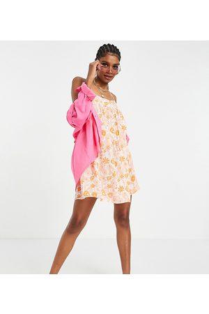 ASOS ASOS DESIGN tall bow back beach mini dress in tropical print-Multi