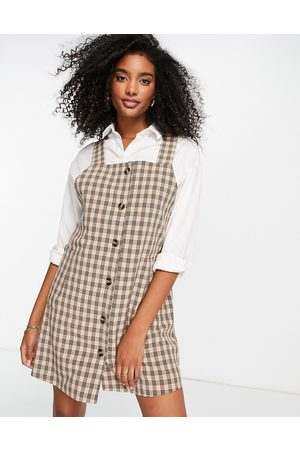VILA Dungaree mini dress with button front in check print-White