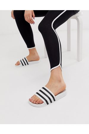 adidas Adilette sliders in white and black