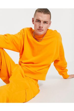 ASOS Co-ord oversized sweatshirt with exaggerated sleeve in bright orange