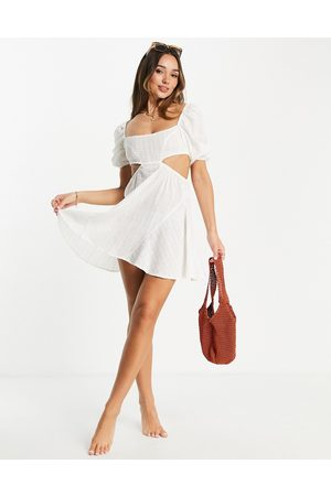 Fashion Union Exclusive cut out mini beach dress with puff sleeves in white broderie