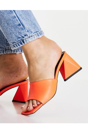 ASOS Halliwell block heeled mules in orange