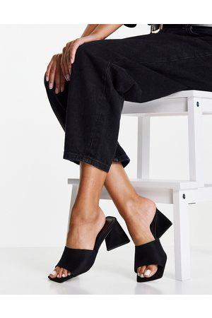 ASOS Halliwell block heeled mules in black