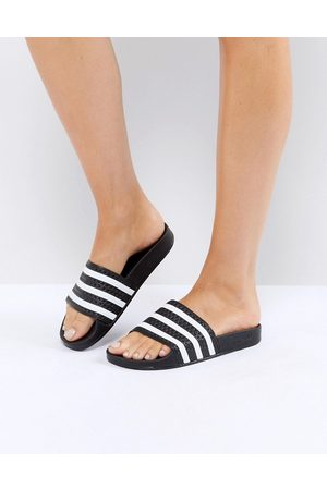 adidas Adilette sliders in black and white