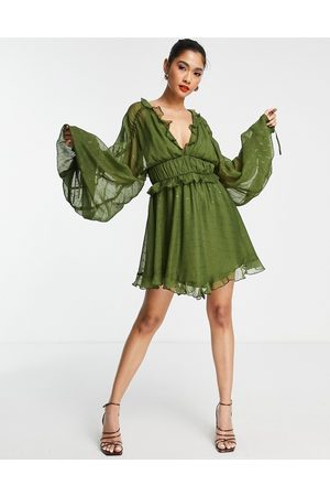 ASOS Tiered soft mini dress in textured chiffon with ruffle detail-Green