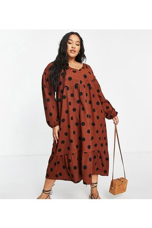 ASOS ASOS DESIGN Curve midi smock dress with long sleeves and tiered hem in brown and black spot
