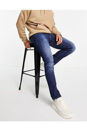 JACK & JONES Intelligence Glenn slim fit jeans in midwash blue