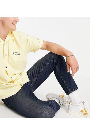 Reclaimed Inspired slim tapered jean in dark blue wash