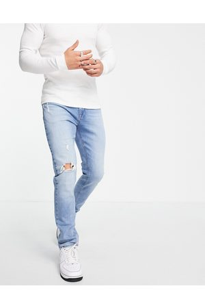 ASOS Skinny jeans in light wash blue with abrasions