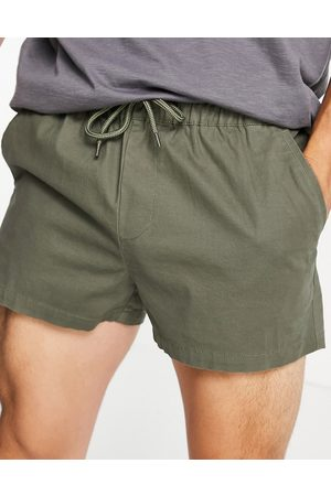ASOS Slim super short chino shorts with elasticated waist in green