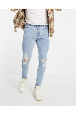 ASOS Herre Skinny - Spray on 'vintage look' jeans with powerstretch in light wash with knee rips-Blue